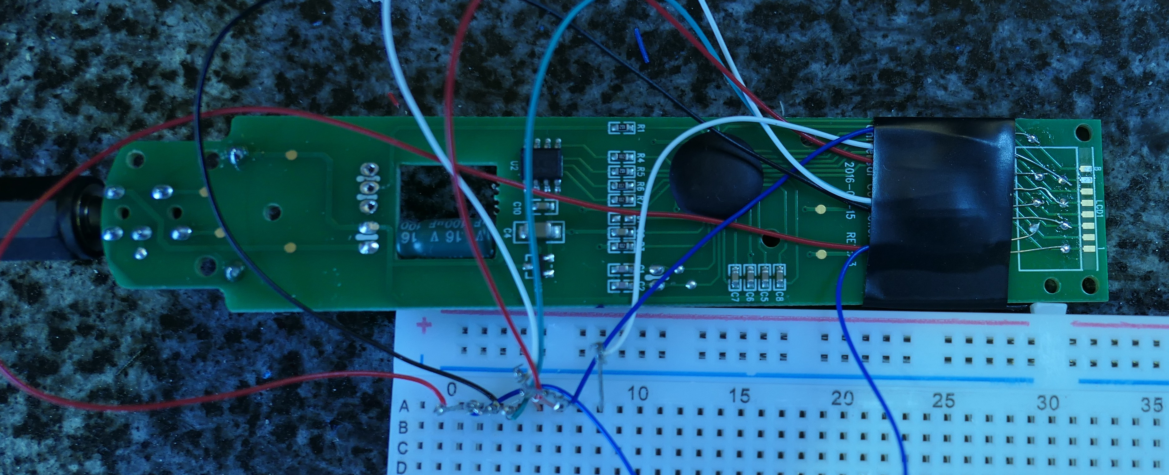 Wiring the LCD into a breadboard by using the test points.